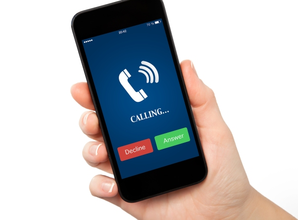 isolated woman hand holding a touch phone with blue screen and the phone ringing icon