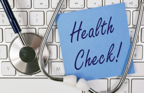 Health Check - blue note paper on keyboard with stethoscope
