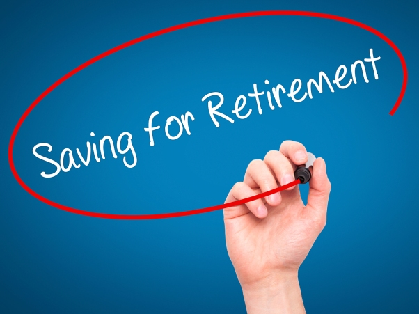 Man Hand writing Saving for Retirement with black marker on visual screen.  Business, technology, internet concept.