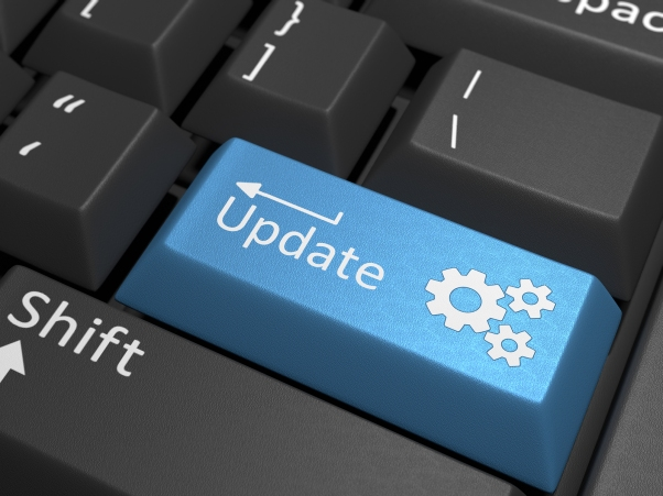 Software Update - A blue key on a black keyboard containing the text update.