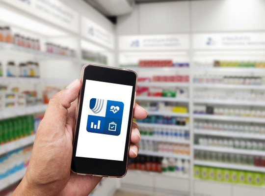 Hand man with smart phone mobile white screen on blurred pharmacy store background